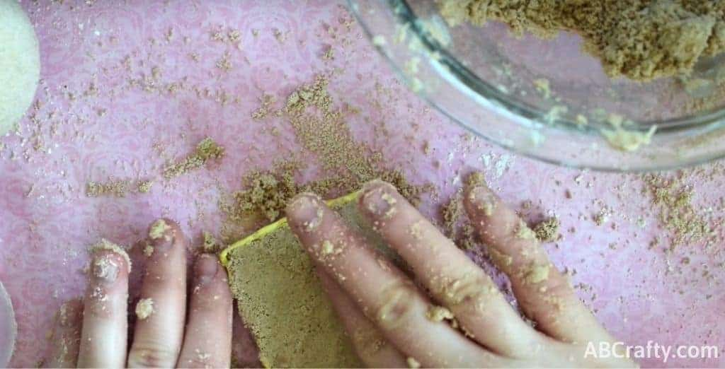 Pressing mixture into chocolate bar mold