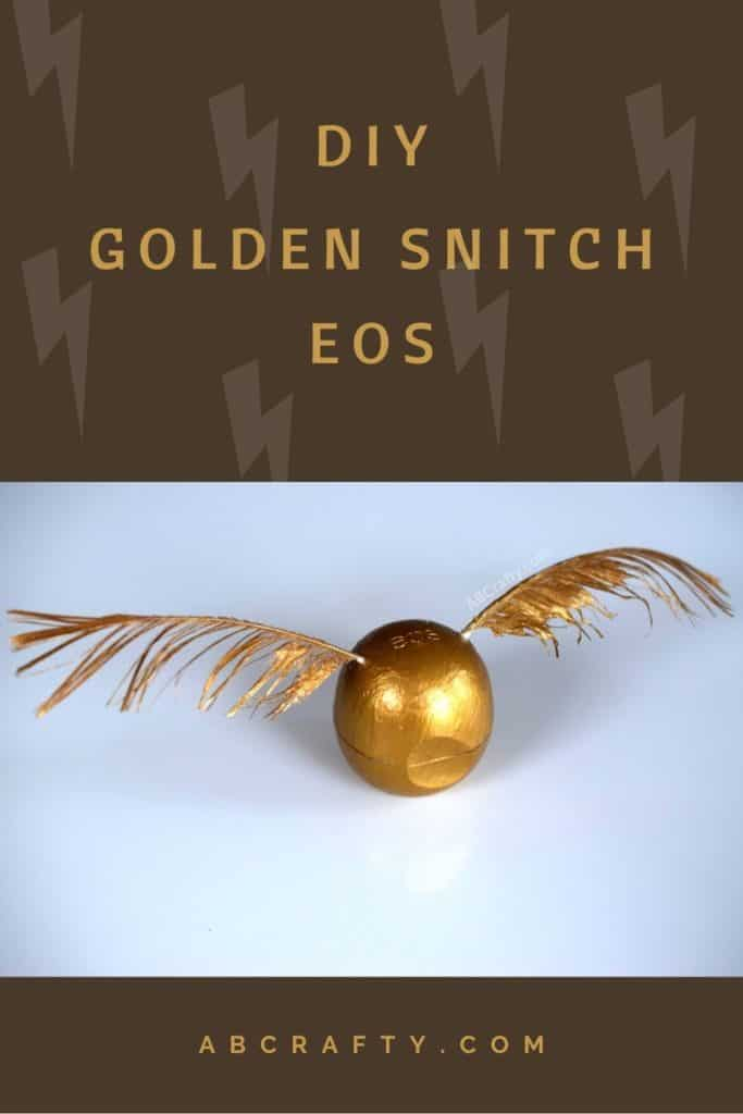 """Handmade Harry Potter craft that looks like the golden snitch from quidditch at Hogwarts. It's made of an eos and feathers and painted with gold paint. The background has lightening bolts that represent Harry's scare. The title reads """"DIY golden snitch eos"""" and has abcrafty.com at the bottom"""