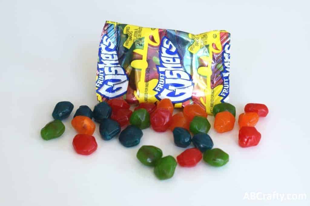 Gushers candy in front of the bag