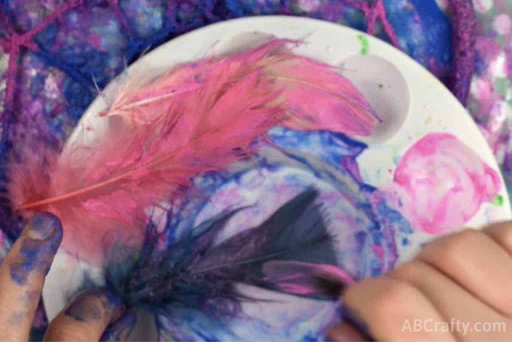 Painting feathers in galaxy colors