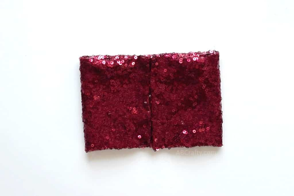 Red sequin fabric folded into a rectangle