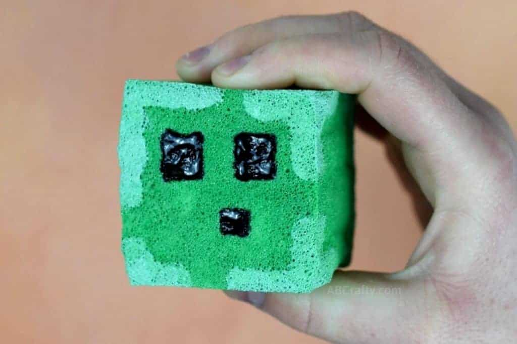 Holding finished DIY squishy in the shape of a Minecraft slime block