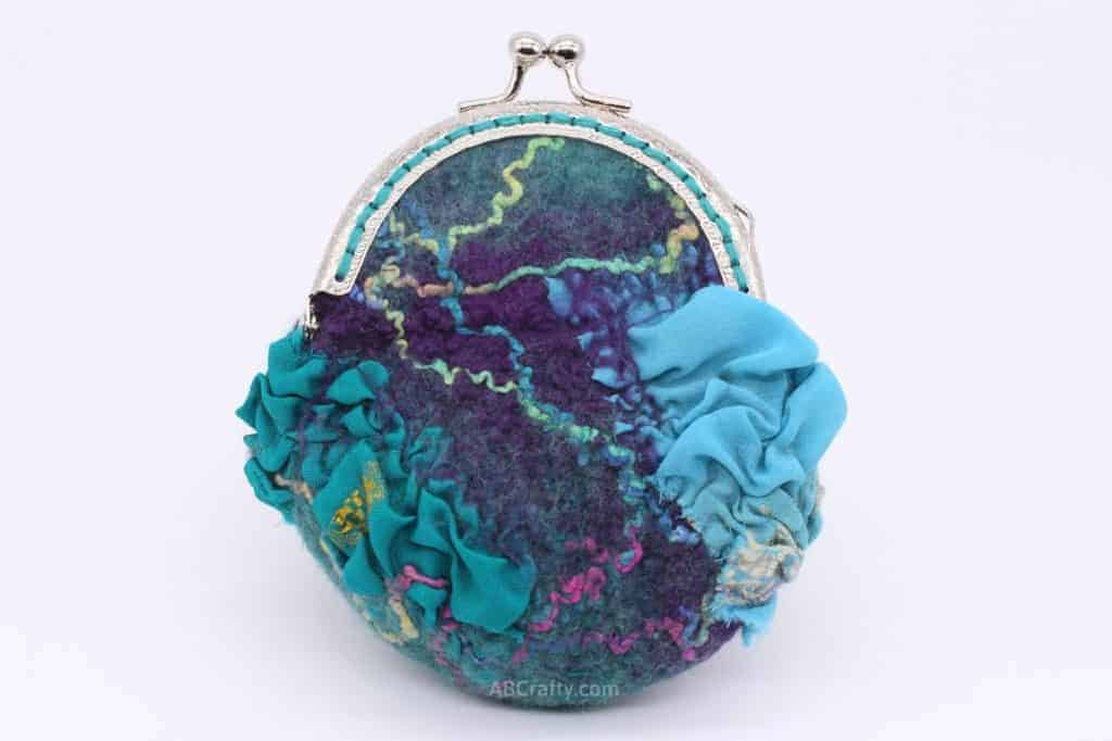 Finished handmade felted coin purse made of wool, silk, yarn, with a metal kiss clasp