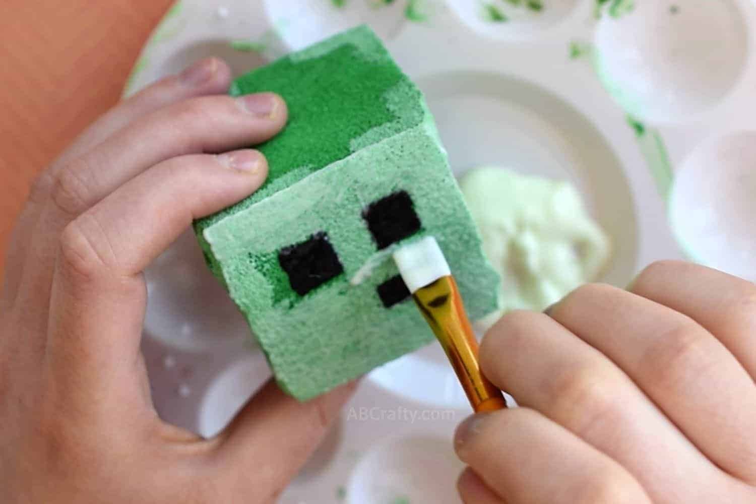 Painting Minecraft squishy slime block with glow in the dark fabric paint using a paintbrush