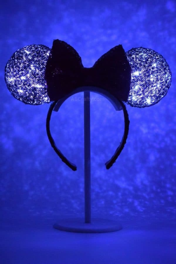 DIY light up Minnie Mouse ears lit up in the dark