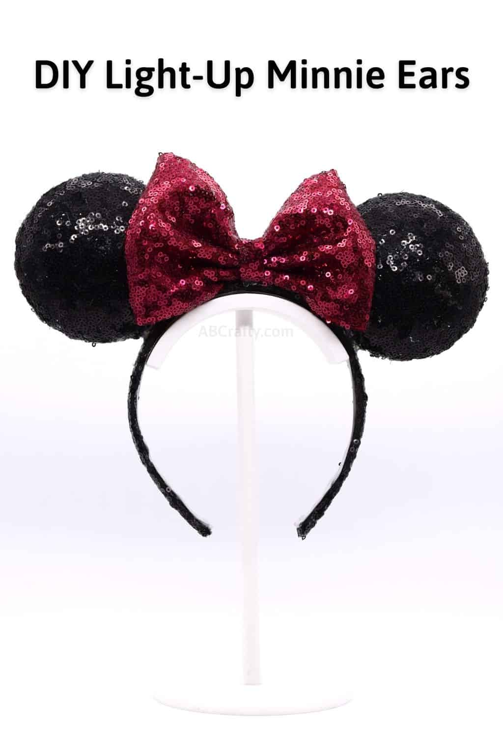 Titled DIY Classic Light Up Minnie Ears. It's a black sequined headband with a red sequined bow, creating the classic Disney Minnie Mouse ears