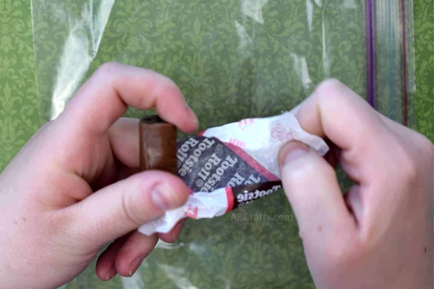 Unwrapping a tootsie roll