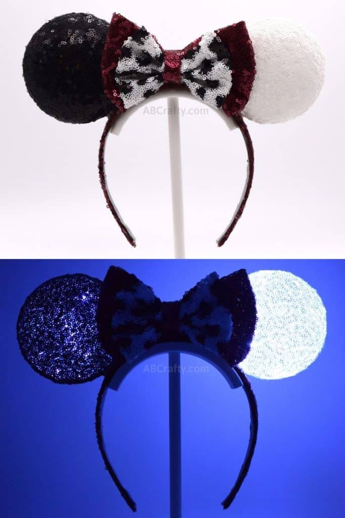 Cruelle Deville Mickey Ears with black and white sequin ears on a black headband. Second photo of the 101 Dalmations Disney ears lit up in the dark