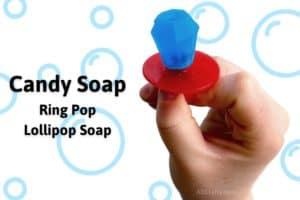 "Holding blue candy soap in the shape of a ring pop with the title ""Candy Soap Ring Pop Lollipop Soap"""