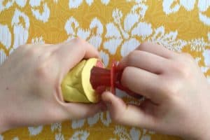 Pulling a red ring pop after a handmade yellow mold made from mold putty