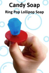 "Holding a ring pop made out of soap with the title ""Candy soap - ring pop lollipop soap"""