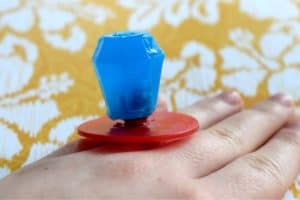 Wearing a blue ring pop soap on a hand