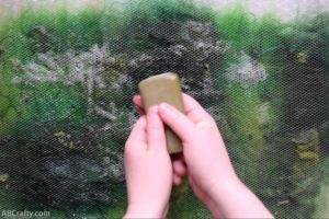 Rubbing hands with olive oil soap