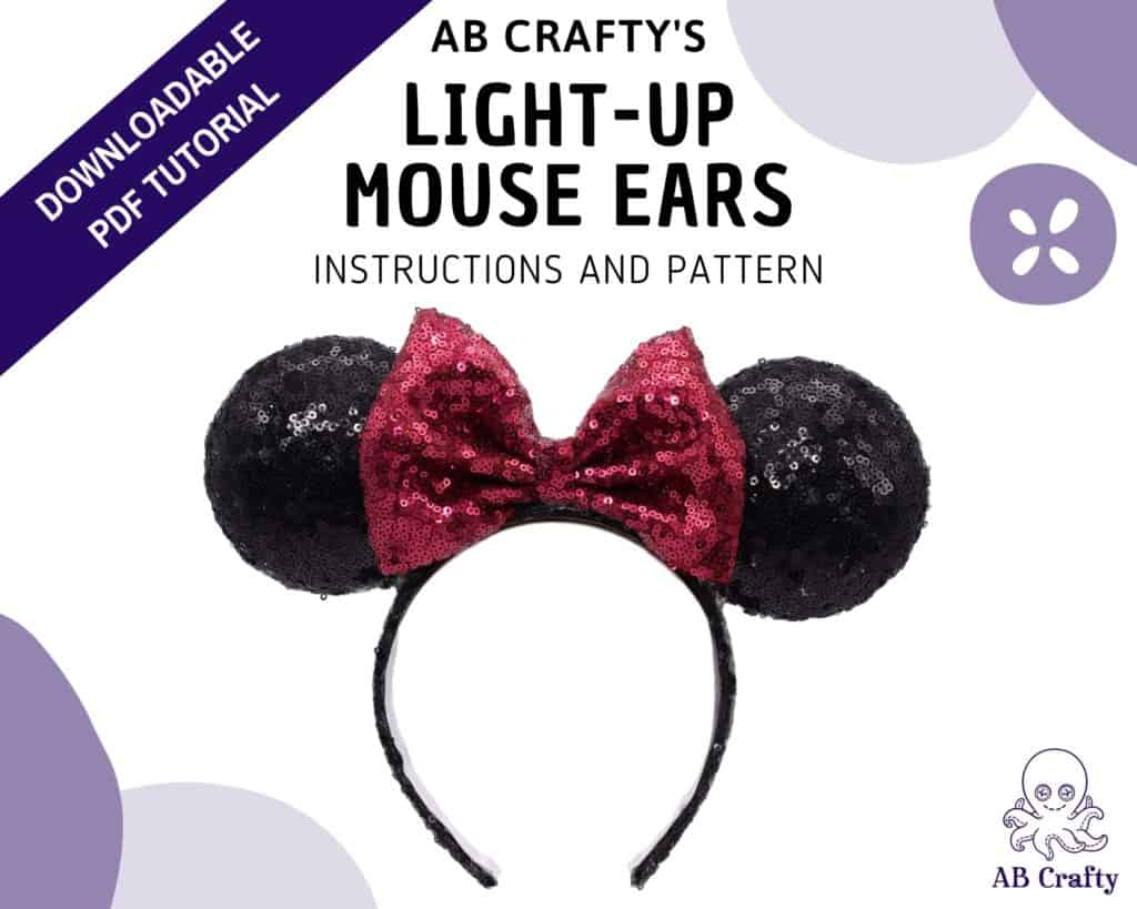 """Cover image of """"ab crafty's"""" light-up mouse ears, instructions and pattern"""" with a finished minnie mouse headband in the middle and the ab crafty octopus logo in the bottom. A banner across the top left corner reads """"downloadable pdf tutorial"""