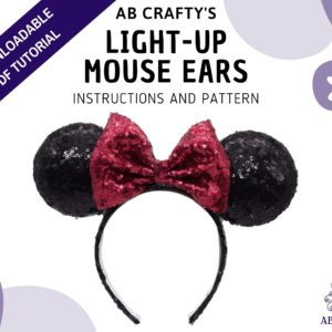 "Cover image of ""ab crafty's"" light-up mouse ears, instructions and pattern"" with a finished minnie mouse headband in the middle and the ab crafty octopus logo in the bottom. A banner across the top left corner reads ""downloadable pdf tutorial"