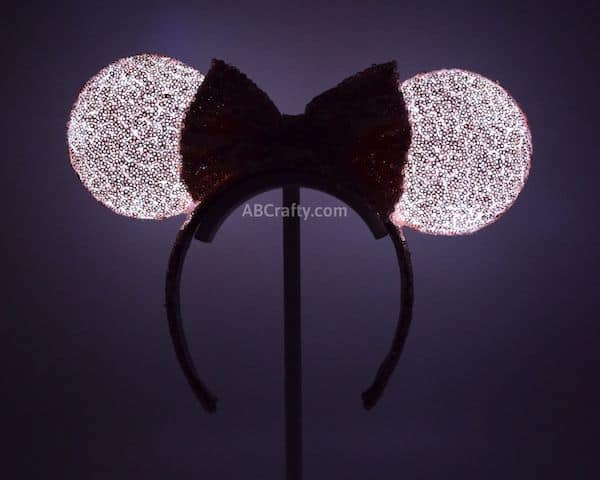 diy minnie mouse ears lit up in the dark, glowing slightly pink