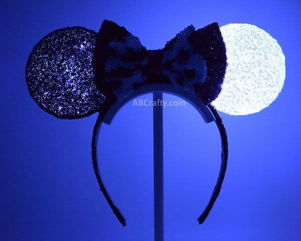 DIY disney ears inspired by 101 dalmatians and Cruella Deville lit up in the dark so that one ear is still black and the other shines white