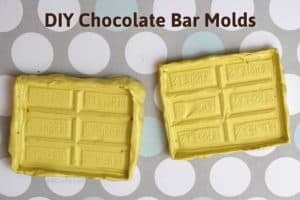 two yellow homemade hershey bar molds on top of a polka dot background with the text 'diy chocolate bar molds' on top