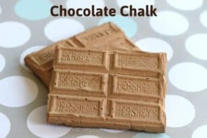 two chocolate sidewalk chalk pieces stacked on top of each other with the title 'chocolate chalk' on top