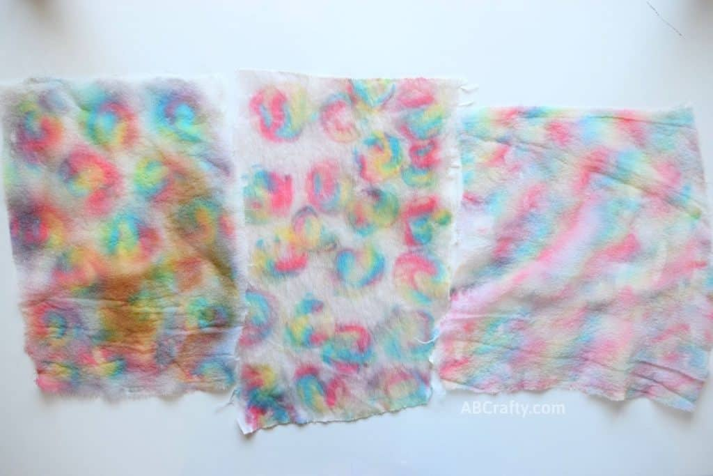 Completely dyed silk and satin fabrics revealing a rainbow tie dye effect