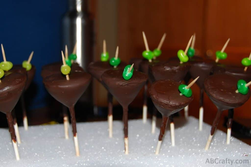 Row of martini glass cake pops pressed into a foam block or cake pop stand