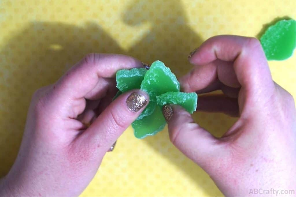assembling multiple sections of the candy succulent made of green mint gummies