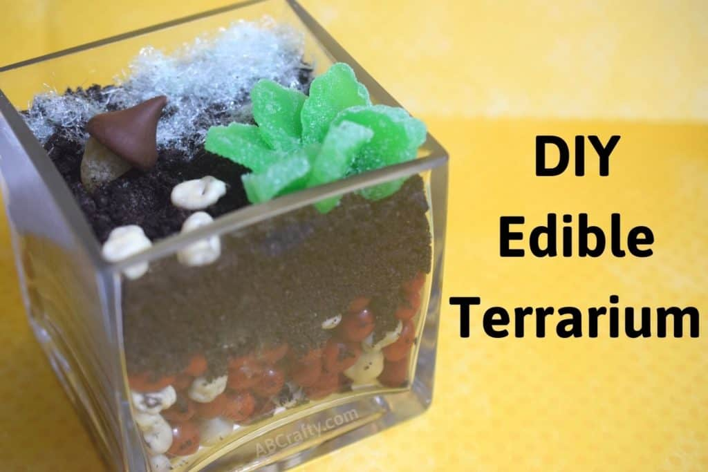 """glass terrarium made with candy including candy succelents and cotton candy grass. Title reads """"food craft, edible diy terrarium"""""""