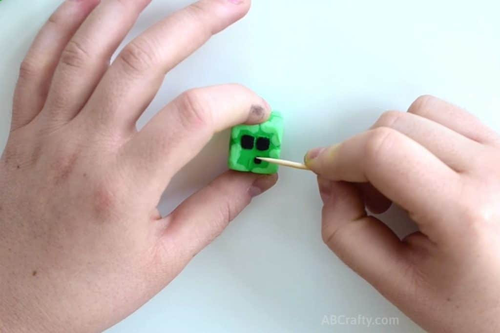 adding the face to minecraft eraser in the shape of a slime block