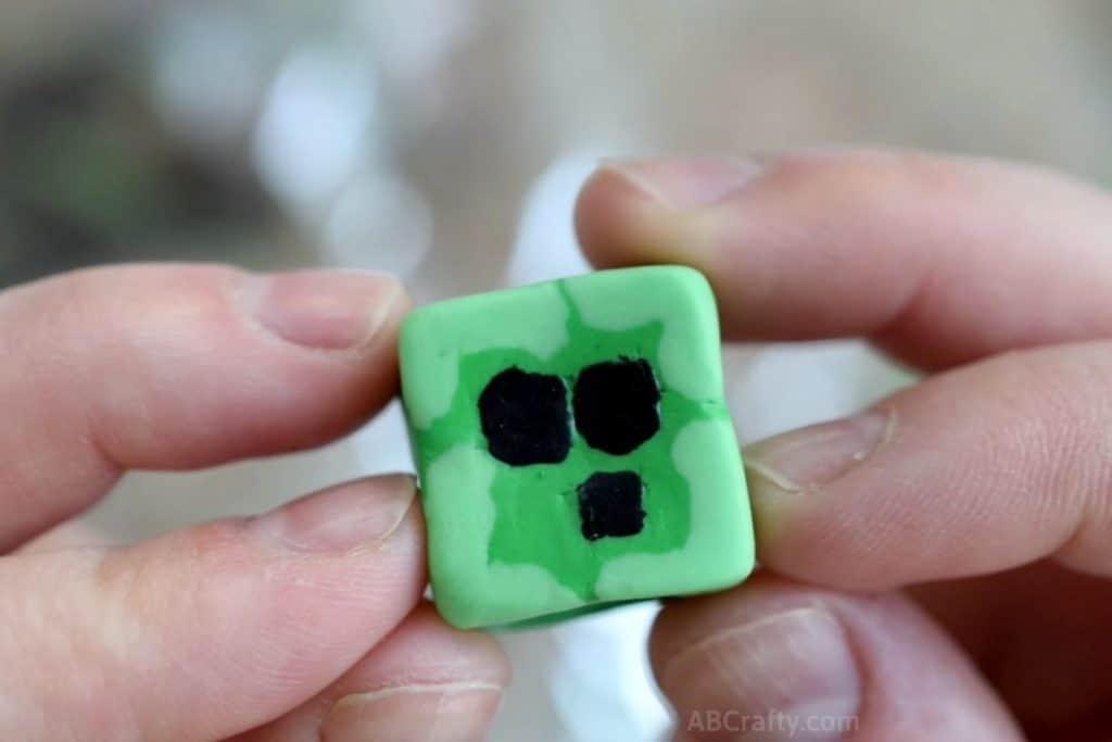 holding a finished minecraft slime block eraser