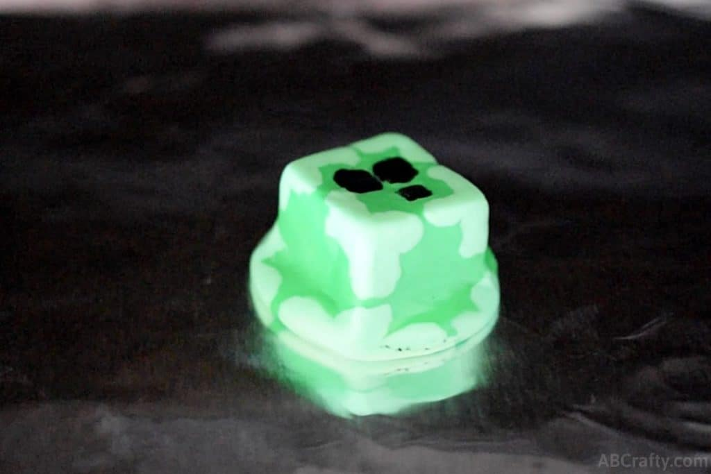 homemade eraser in the shape of a minecraft slime chunk melted on aluminum foil