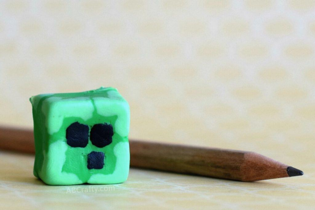 finished homemade slime block minecraft eraser made from creatibles diy eraser kit next to a pencil