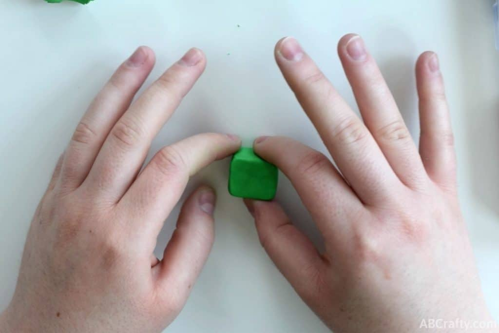 shaping green eraser clay into a cube