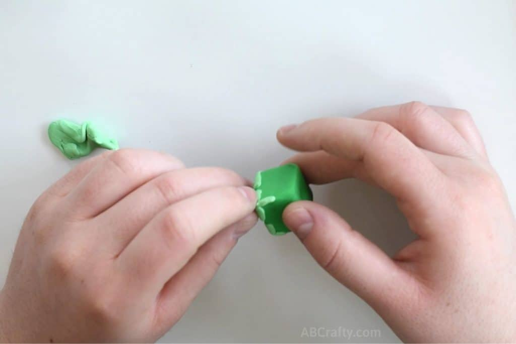 adding a small stripe of light green clay to a cube