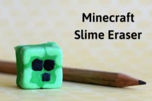 homemade minecraft eraser in the shape of a minecraft slime block in front of a pencil with the title 'minecraft slime eraser'