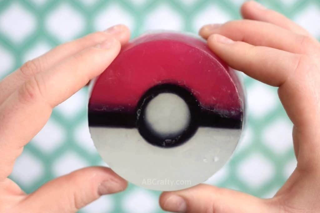 holding a homemade pokeball soap with two hands