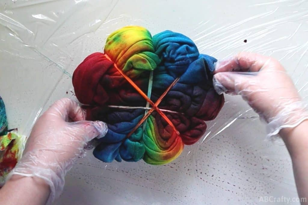 squishing red and blue tie dye to make purple