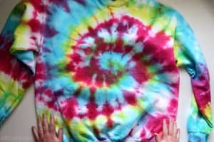 showing the bottom of a rainbow tie dye sweatshirt to show the tie dye spiral