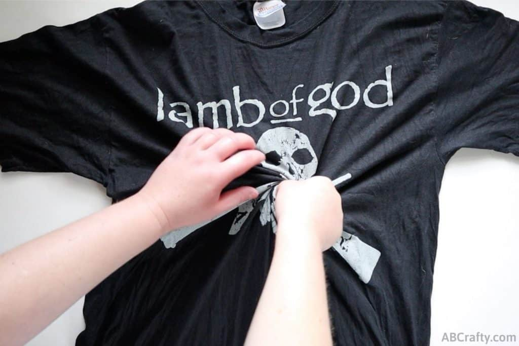 black lamb of god t shirt getting twisted from the middle