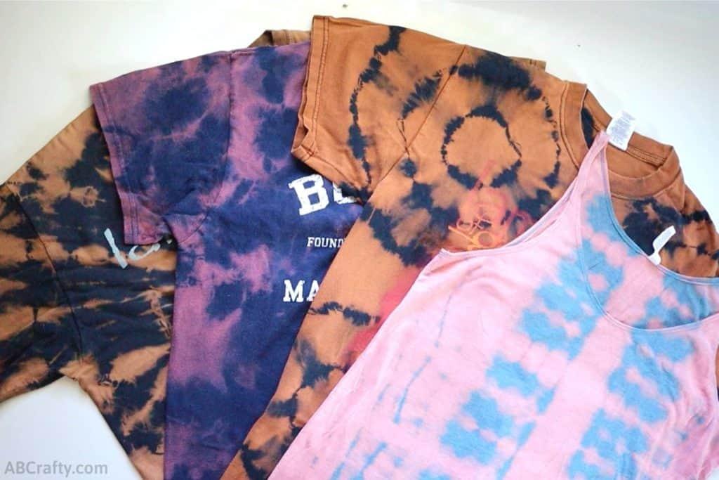 3 bleach tie dye t shirts and 1 bleach tie dye tank top
