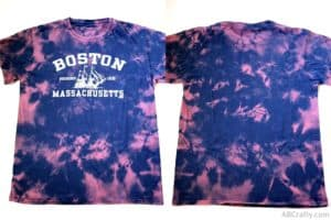 a bleach tie dye navy boston t shirt with pink splotches from scrunching