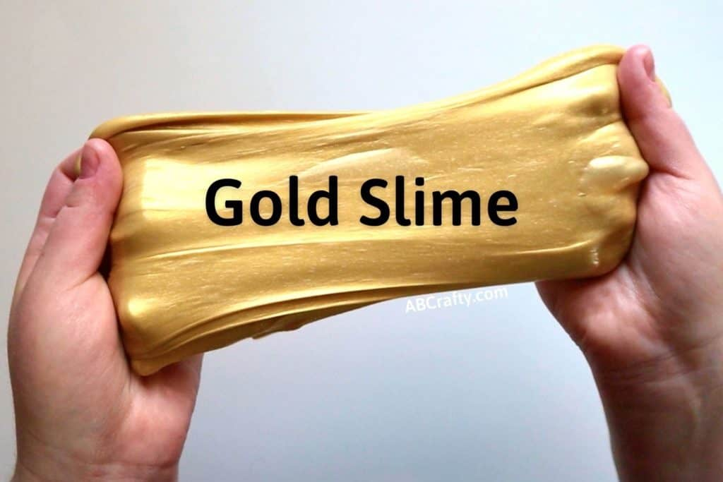 """hands holding metallic slime with the title """"gold slime"""""""