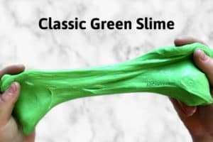 two hands stretching green slime