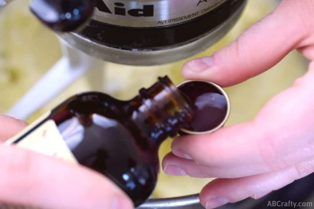 pouring vanilla extract into cap