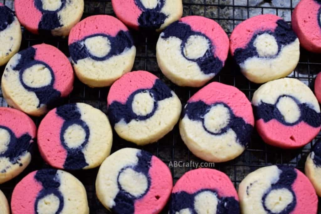 pokemon cookies on cooling rack in the shape of pokeballs