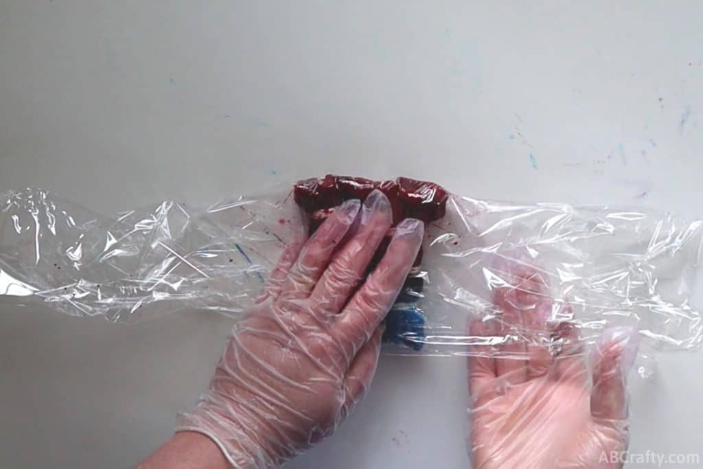 wrapping plastic around dyed articles of clothing