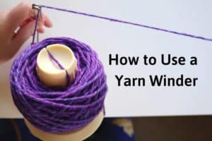 """a purple ball of yarn on a yarn winder with the title """"how to use a yarn winder"""""""
