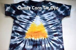 """finished candy corn tie dye t shirt with candy corn design in the middle and black around the edge and the title """"candy corn tie dye"""""""