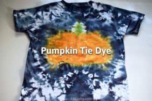 """finished tie dye pumpkin shirt with a pumpkin in the middle and black tie dye edges with the title """"pumpkin tie dye"""""""