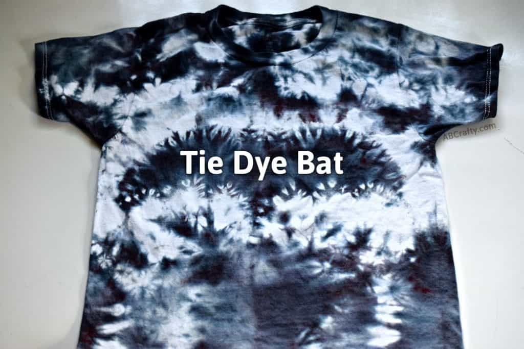 """finished black tie dye shirt with the title """"tie dye bat"""" on top"""