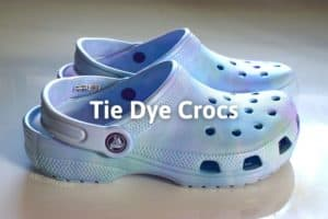 """the finished DIY dyed crocs on the table with the title """"tie dye crocs"""""""